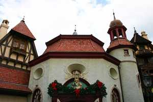 The Christmas scene can be found within the World Showcase above the door at the Germany pavilion at Epcot.