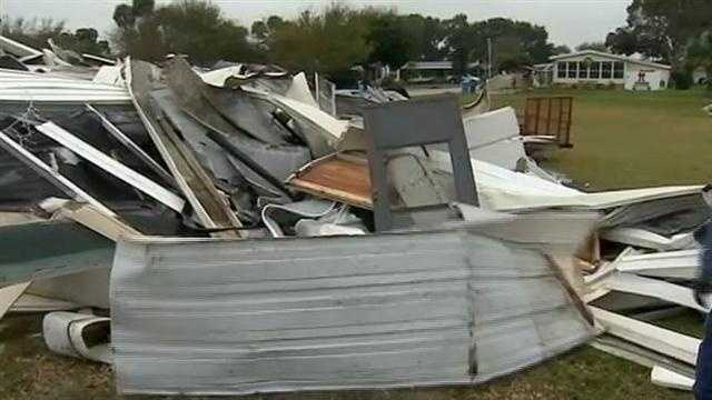 Three days after a tornado tore through a portion of a mobile home community in Edgewater, victims continue the cleanup.