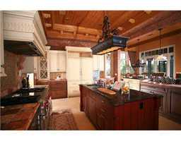 Rustic-chic features throughout this one-of-a-kind kitchen, also features a spacious island and bar seating.