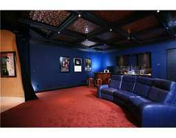 A large entertainment room, features modern decor and comfortable seating area.