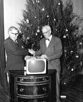1962: A Kiwanis Club representative hands out a television at its annual Christmas party.