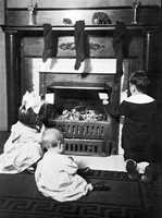 1915: The Greenwood children write and leave letters for Santa near the fireplace.
