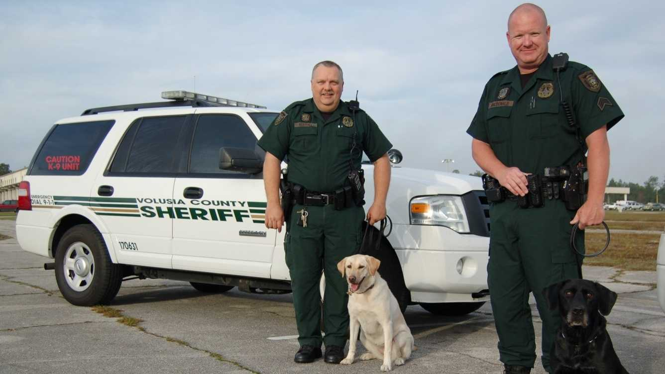 Deputy Christopher Westfall with Holly (left) and Sgt. David MacDonald with Bandit.