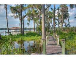 The home features a private dock with access to the lake. For more information on this home, please visit Realtor.com.