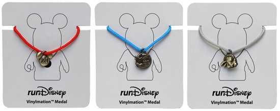 Mini-medals are now available for the Vinylmation figures.  The full marathon, half marathon and Goofy's race medals can be added to each figure and are sold separately.