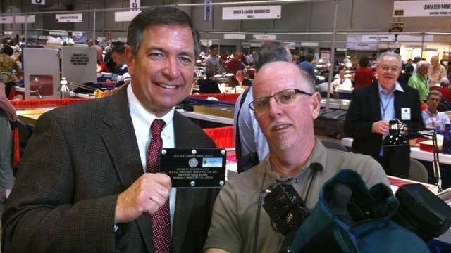 WESH 2's Greg Fox and Tim Brown pose with the coin.