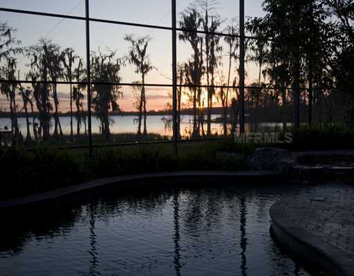 Tranquility and privacy are afforded by over 400 feet of shoreline on the Butler Chain of Lakes.