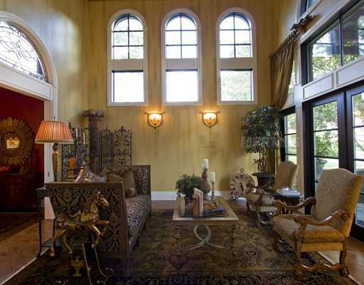 This elegant room is only made more beautiful by the enchanting windows on every wall.
