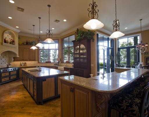 Stunning, yet functional, the kitchen boasts a large island, two sub zero refrigerators, three sink areas, two dishwashers, double warming drawers, gas cook top with pot filler, ice makers and designer cabinets.