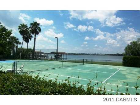 The grounds include a tennis court, pool, cabana and a dock.