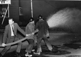 Firefighters in Tallahassee fight a Crow's Grocery store fire at 1902 Lake Bradford Road during riots one day after the assassination of King in 1968.