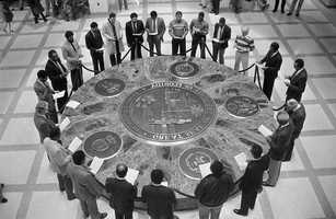 Men gather around the Florida Seal to honor Dr. Martin Luther King in Tallahassee in 1986.
