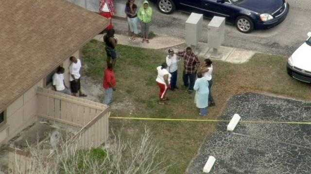Authorities searched the area near an apartment complex where two women were shot Monday.