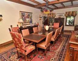Antique decor is celebrated in this one-of-a-kind dining room, making the property reminiscent of the home it once was.