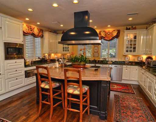 The kitchen was remodeled in 2005. Now, it is equipped with all the modern amenities and functional cabinet space.