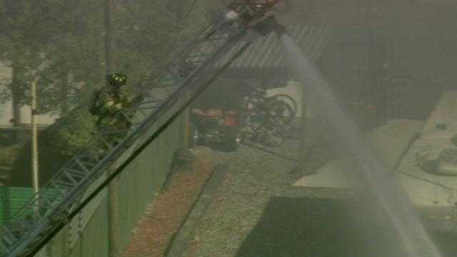 Fire crews are working to put out a fire at a salvage yard in DeLand.