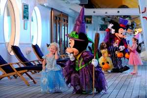 Like Christmas, Minnie has several Halloween outfits.  Her purple witch costume is used aboard a Disney cruise ship.