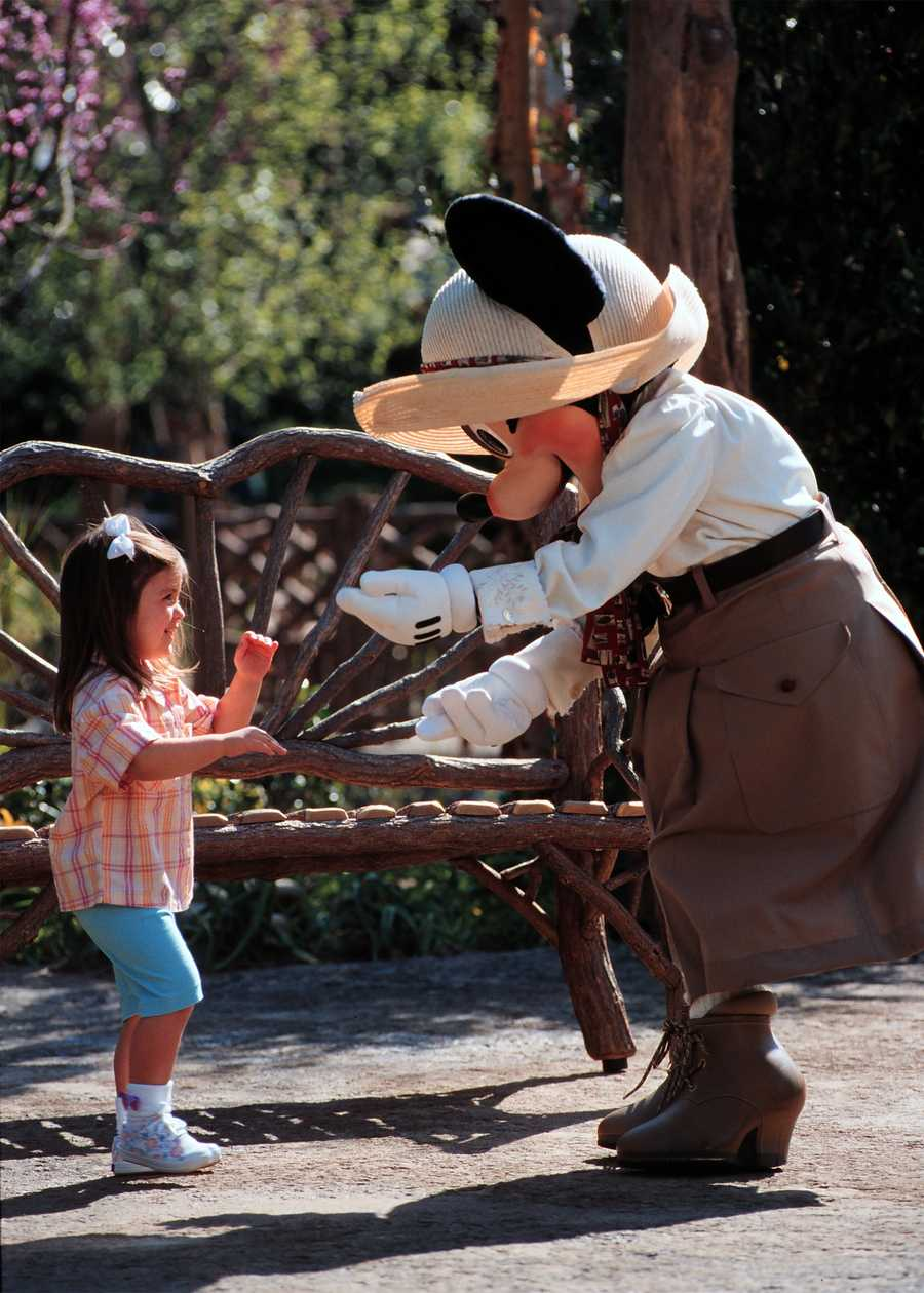 Minnie greets a Disney park guest in her safari outfit.  She is ready for the wilderness, or maybe the Wilderness Lodge.