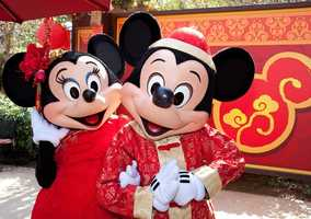 Minnie is not going to let Mickey be outdone in his Asian-inspired attire.