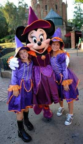 Another Halloween outfit for Minnie outside of the Haunted Mansion at the Magic Kingdom.