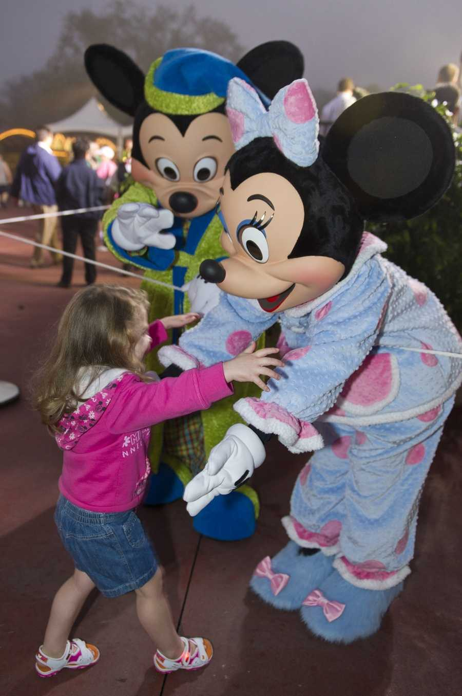 "For Disney's ""One More Disney Day"" Minnie and Mickey greeted guests for the 24-hour celebration in their pajamas."