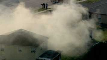 Fire crews worked to put out a fire at a home on Country Run Parkway near Hiawassee Road Thursday.