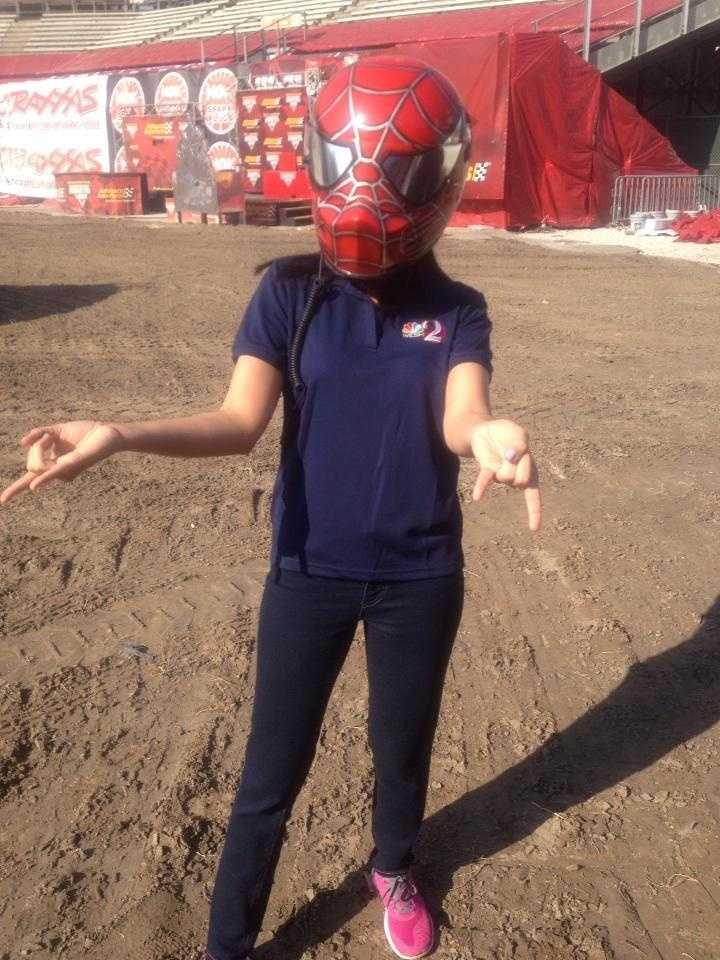 Aixa tries on the Spiderman helmet.