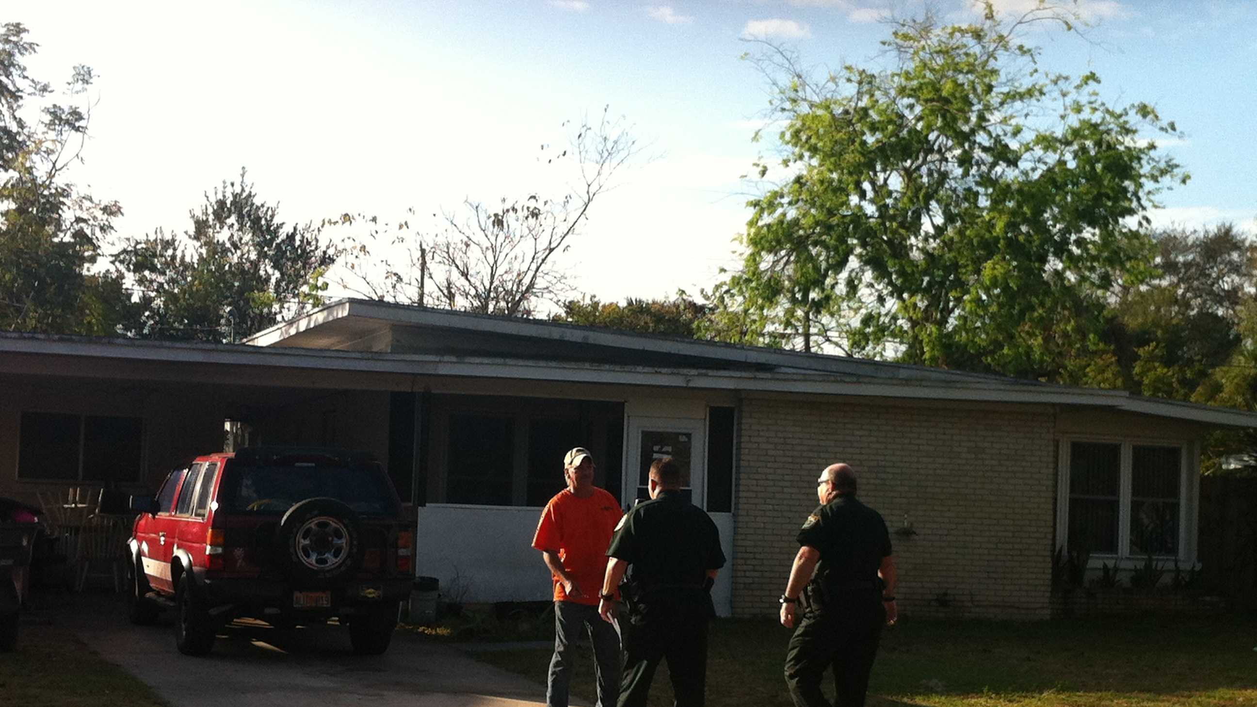 Deputies serve Bruce Blake with an eviction notice.