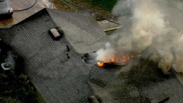 Rescuers worked the fire on Littleton Court in the Watermill subdivision.