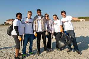 VoluntEARS pose after clearing 250 pounds of trash off of a Brevard County beach. Read the story