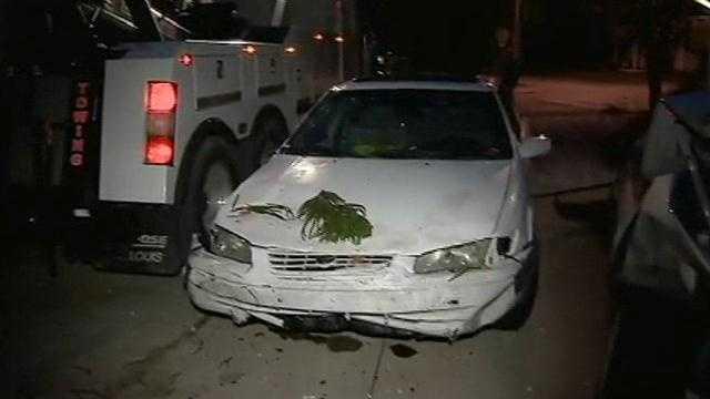 Car hits boat, car, tree, house in New Smyrna Beach