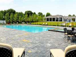 The expansive grounds feature a large pool space.