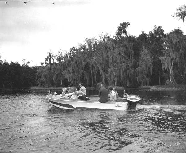 The group inspects the property by boat.