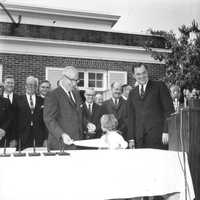 Roy Disney with Gov. Claude Kirk after the bill was signed.