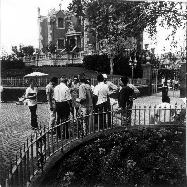A group gets a tour of the Magic Kingdom when it opens.