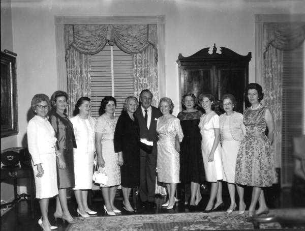 Walt Disney poses for photographs.