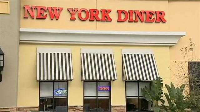 Another Orange County restaurant employee is facing charges Wednesday, accused of swiping credit card information from customers.