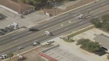 A woman was airlifted to a hospital after reports said she was trapped under a car in Orange City
