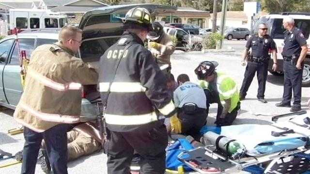 A woman was airlifted to a hospital after she was trapped under a car in Orange City.