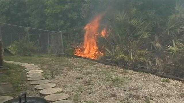 Several homes in Merritt Island are threatened by a brush fire.