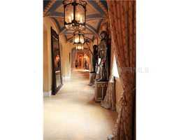 Medieval accents line the hallways and archways of this extravagant mansion.