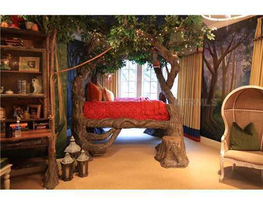 Bedroom features a whimsical tree-house inspired bed set. Fun for girls and boys.