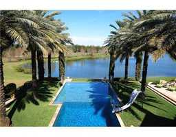 Beautiful pool area takes advantage of the 1.05 acre property and proximity to the Chain of Lakes.