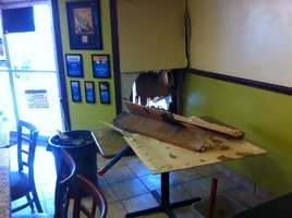 The table where two people were sitting and eating inside the restaurant when the crash happened.