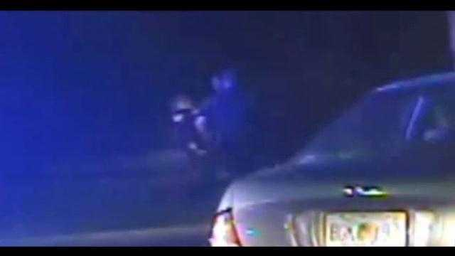 Dashcam video shows a Longwood police officer getting punched in the face Thursday night.