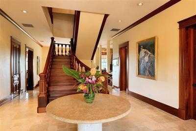 Marble floors are illuminated by beautiful mahogany staircases.