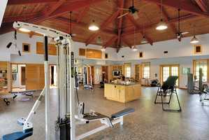 The 2,803 square foot fitness center comes with a sauna and bath.