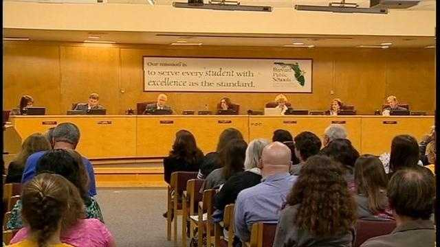 Parents sue school board over planned closure of schools