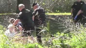 County fire officials and deputies found her sitting in some grass beside the lake.