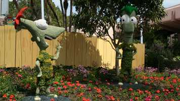 Phineas and Ferb hang out near the Epcot fountain.